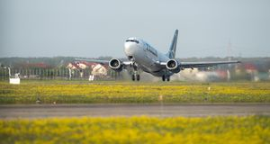 Tarom Timisoara Skyteam commercial airplane takeoff from Otopeni airport in Bucharest Romania. Plain spotters close up stock photography