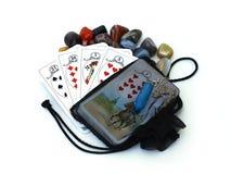 Tarot. Deck of tarot cards with black bag, cristals and pendulum Royalty Free Stock Photo