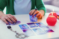 Tarot card being opened by a fortune teller. Prediction of future. Tarot card being opened by a fortune teller while predicting the future stock photo