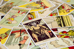 Tarot card Devil. Moscow, Russia - December 4, 2016: Tarot card Devil with other cards. Rider-Waite tarot deck. Esoteric background Stock Photo