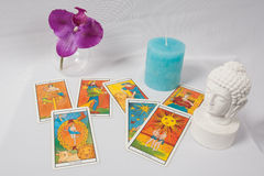 Tarot card of divination. Orchid , candle and buddha stock image