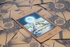 Tarot card The Moon. Labirinth tarot deck. Esoteric background. Moscow, Russia - January 29, 2017: Tarot card The Moon. Labirinth tarot deck. Esoteric Royalty Free Stock Images