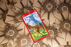 Tarot card Nine of Swords. Dragon tarot deck. Esoteric background. Moscow, Russia - February 18, 2018: Tarot card Nine of Swords. Dragon tarot deck. Esoteric Royalty Free Stock Photos