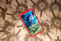 Tarot card Seven of Swords. Dragon tarot deck. Esoteric background. Moscow, Russia - February 18, 2018: Tarot card Seven of Swords. Dragon tarot deck. Esoteric Stock Photography