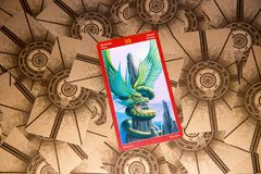 Tarot card Ten of Pentacles. Dragon tarot deck. Esoteric background. Moscow, Russia - February 18, 2018: Tarot card Ten of Pentacles. Dragon tarot deck Stock Image