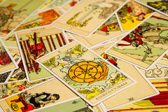 Tarot card Wheel of Fortune. Moscow, Russia - December 4, 2016: Tarot card Wheel of Fortune with other cards. Rider-Waite tarot deck. Esoteric background Royalty Free Stock Images