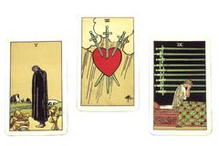 Tarot Cards. Three tarot cards representing pangs of love, on white background Royalty Free Stock Photography