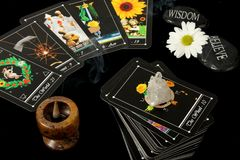 Tarot Cards. Deck of tarot cards spread on table, with crystal, flower and incense burner Royalty Free Stock Image