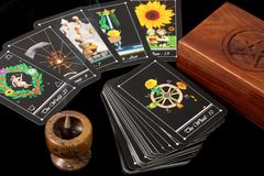 Tarot Cards. Deck of tarot cards spread on table, with wooden box and incense burner Stock Photo
