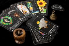 Tarot Cards. Deck of tarot cards spread on table, with crystal, bell and incense burner Royalty Free Stock Photo