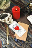 Tarot cards with  burning candle Stock Photos