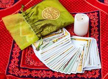 Tarot cards and burning candle Stock Image