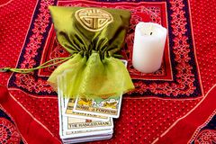 Tarot cards and burning candle Royalty Free Stock Photo