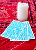 Tarot cards and burning candle Stock Photo
