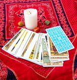 Tarot cards and burning candle Stock Photos