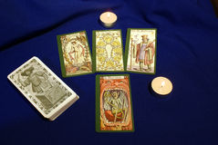 Tarot cards with candles on blue textile. Old styled tarot cards with candles on blue textile Stock Photography