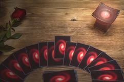 Tarot cards. Future reading. Fortune teller desk table. Romantic divination. Tarot cards deck on fortune teller table background with copy space. Future reading Royalty Free Stock Photos