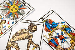 Tarot cards for divination with death. On white table Royalty Free Stock Photos