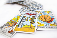 Tarot cards. Divination and prediction three Tarot cards the best choice, love, money and luck on a white background royalty free stock photo