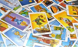 Tarot Cards 78 Cards The Fool. A deck of cards displayed on a table.Tarot cards based on the Rider-Waiter system. The Fool card in the center royalty free stock photography