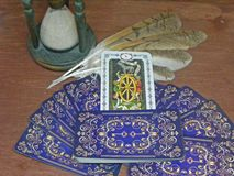Tarot cards Fortune with owl feathers and antique hourglass royalty free stock image