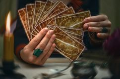 Tarot cards. Future reading. Fortune teller concept. Tarot cards on fortune teller desk table. Future reading. Woman fortune teller holding in hands a deck of stock photo