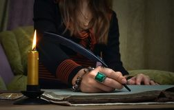 Book of magic. Future reading. Tarot cards on fortune teller concept. Tarot cards on fortune teller desk table. Future reading. Woman witch writes a magic Royalty Free Stock Image