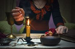 Woman witch prepare a magic potion. Tarot cards. Future reading. Fortune teller concept. Tarot cards on fortune teller desk table. Woman witch prepare a magic Royalty Free Stock Photography