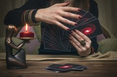 Tarot cards. Fortune teller. Divination. Tarot cards on fortune teller desk table. Future reading concept. Divination Royalty Free Stock Image