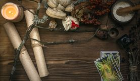 Tarot cards. Fortune teller. Divination. Witch doctor. Tarot cards on fortune teller desk table. Witch doctor. Witchcraft. Magic herbal collection Royalty Free Stock Images