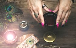 Magic potion. Witchcraft. Magic qure. Shaman. Tarot cards on fortune teller table. Divination. Witchcraft. Witch prepares a magic potion Stock Photography
