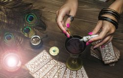 Magic potion. Witchcraft. Magic qure. Shaman. Tarot cards on fortune teller table. Divination. Witchcraft. Witch prepares a magic potion Royalty Free Stock Photography