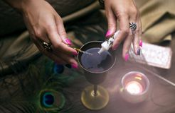 Magic potion. Witchcraft. Magic qure. Shaman. Tarot cards on fortune teller table. Divination. Witchcraft. Witch prepares a magic potion Royalty Free Stock Image