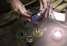 Magic potion. Witchcraft. Magic qure. Shaman. Tarot cards on fortune teller table. Divination. Witchcraft. Witch prepares a magic potion Stock Photos