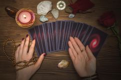 Tarot cards deck. Future reading. Fortune teller. The psychic. Tarot cards and future reading concept. Fortune teller desk table Royalty Free Stock Photography