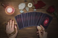 Tarot cards deck. Future reading. Fortune teller. The psychic. Tarot cards and future reading concept. Fortune teller desk table Royalty Free Stock Photo