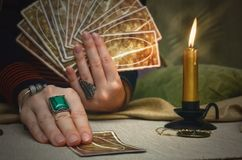 Tarot cards. Future reading. Fortune teller concept. Tarot cards and fortune teller desk table. Future reading. Woman fortune teller holding in one hand a deck Stock Photo