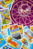Tarot cards with a magic ball on a purple table. royalty free stock photos