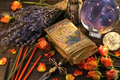 Tarot cards with magic crystal ball, candles and lavender flowers
