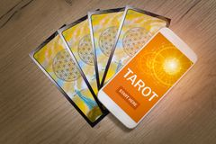 Tarot cards and mobile phone Stock Image