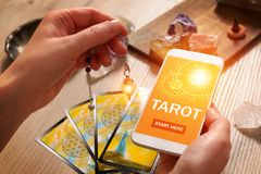Tarot cards and mobile phone Royalty Free Stock Photo