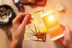 Tarot cards and mobile phone Royalty Free Stock Image