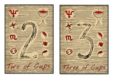 The tarot cards in red. Two and three of cups Royalty Free Stock Images