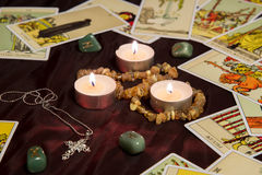 Tarot cards with runes and burning candle. Moscow, Russia - December 4, 2016: Rider-Waite tarot cards with runes and burning candle. Esoteric background Royalty Free Stock Photo