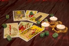 Tarot cards with runes and burning candle. Moscow, Russia - December 4, 2016: Rider-Waite tarot cards with runes and burning candle. Esoteric background Stock Images