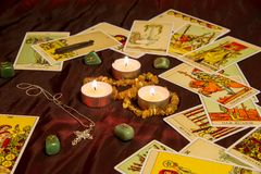 Tarot cards with runes and burning candle. Moscow, Russia - December 4, 2016: Rider-Waite tarot cards with runes and burning candle. Esoteric background Stock Photography