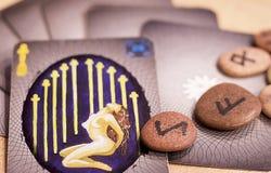 Tarot cards and runes. Runes stones and tarot cards Royalty Free Stock Image