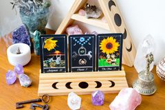 Tarot Cards on stand in Altar space with Moon phase design. Tarot cards in Altar Space - Witch, Wicca, New Age, Pagan with Crystal Shelf and Altar tile with Moon stock photography