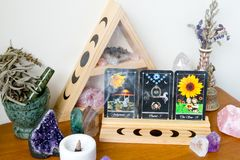 Tarot Cards on stand in Altar space with Moon phase design. Tarot cards in Altar Space - Witch, Wicca, New Age, Pagan with Crystal Shelf and Altar tile with Moon stock photo