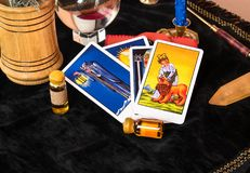 Tarot cards on table. Laid out Tarot cards with magical decorations on the table stock image